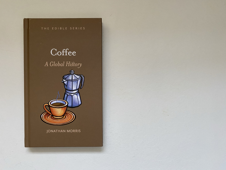 Coffee: A Global History Review book on a white table