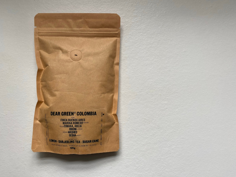 A brown bag of coffee with information about the coffee written on the bag