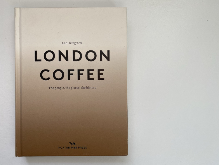 London Coffee book on a white table