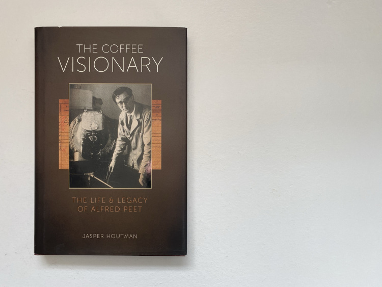 The Coffee Visionary book on a white table